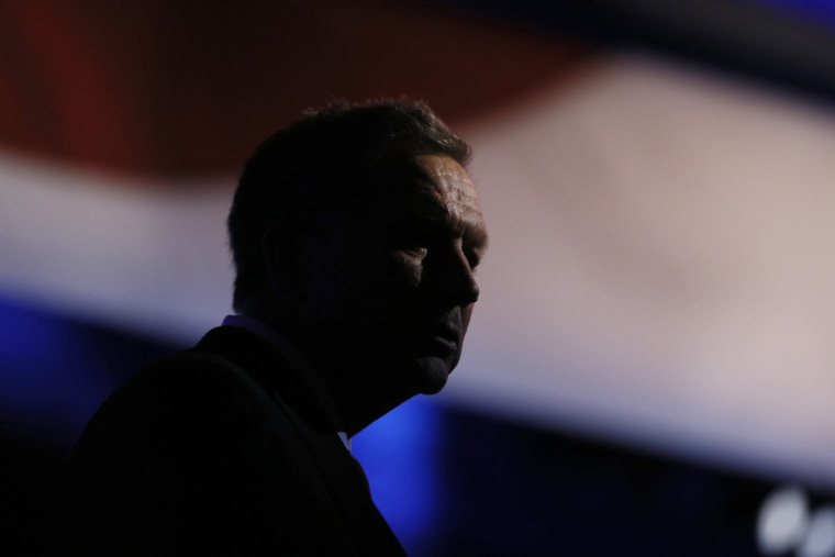 Republican U.S. presidential candidate and Ohio Governor John Kasich stands at his podium after the stage lights dimmed following the 2016 U.S. Republican presidential debate held by CNBC in Boulder, Colo., Oct. 28, 2015. (Photo by Rick Wilking/Reuters)