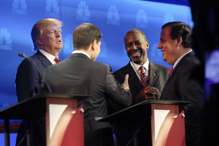 Donald Trump, Sen. Marco Rubio, Ben Carson and Gov. Chris Christie gather to talk during a break in the debate of Republican presidential hopefuls at the University of Colorado in Boulder, Oct. 28, 2015. (Photo by Jim Wilson/The New York Times/Redux)