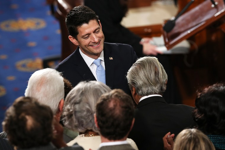Speaker of the House Paul Ryan (R-WI) is congratulated by fellow members of the U.S. House of Representatives on the floor of the House chamber, Oct. 29, 2015 in Washington, DC. (Photo by Win McNamee/Getty)