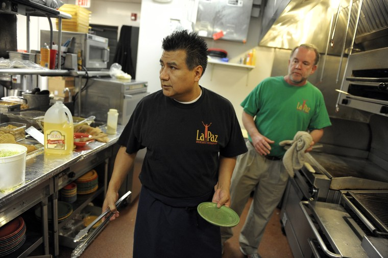 Chef Victor Rojas, a Mexican immigrant and owner of Graham Baker of La Paz Mexican Restaurant, in the kitchen on Feb. 23, 2012 in Frederick, Md. (Photo by Ricky Carioti/The Washington Post/Getty)