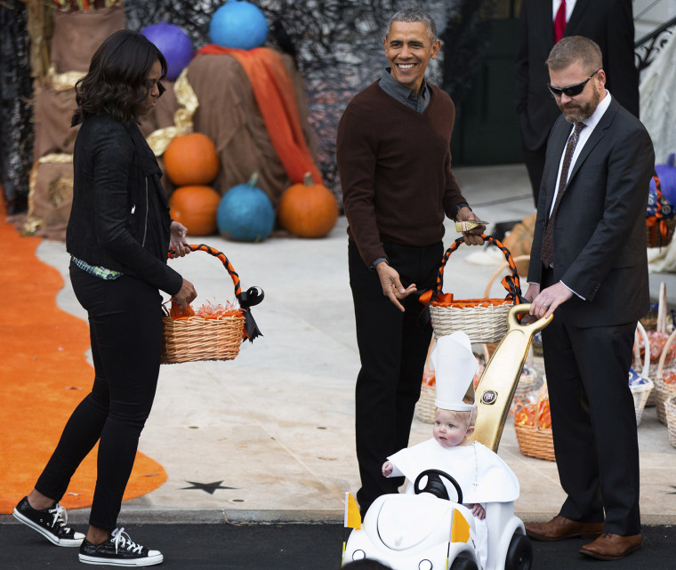 President Barack Obama and first lady Michelle Obama greet a child dressed as the pope during Halloween festivities at the South Portico of the White House in Washington, Oct. 30, 2015. (Photo by Andrew Harnik/AP)