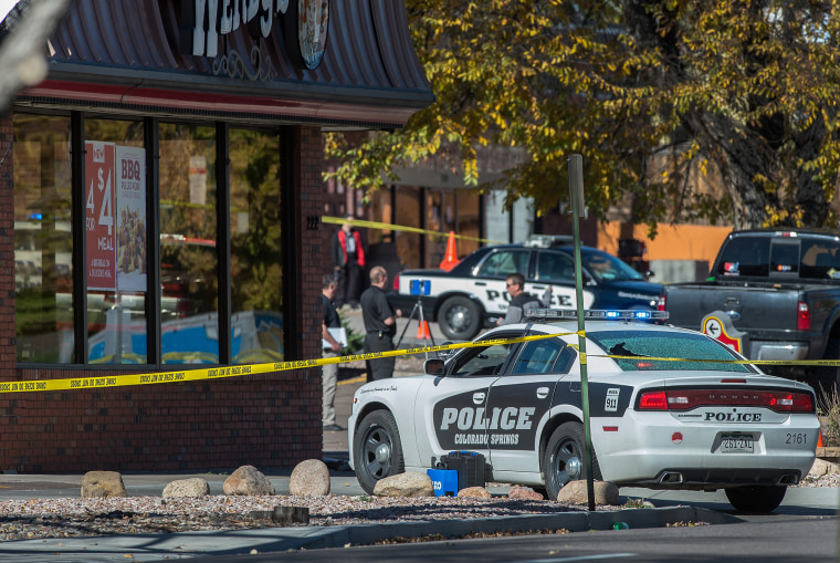 The rear window of a Colorado Springs Police car is shattered after a shooting on Oct. 31, 2015. Multiple are dead, including a suspected gunman, following a shooting spree according to authorities. (Photo by Christian Murdock/The Gazette/AP)