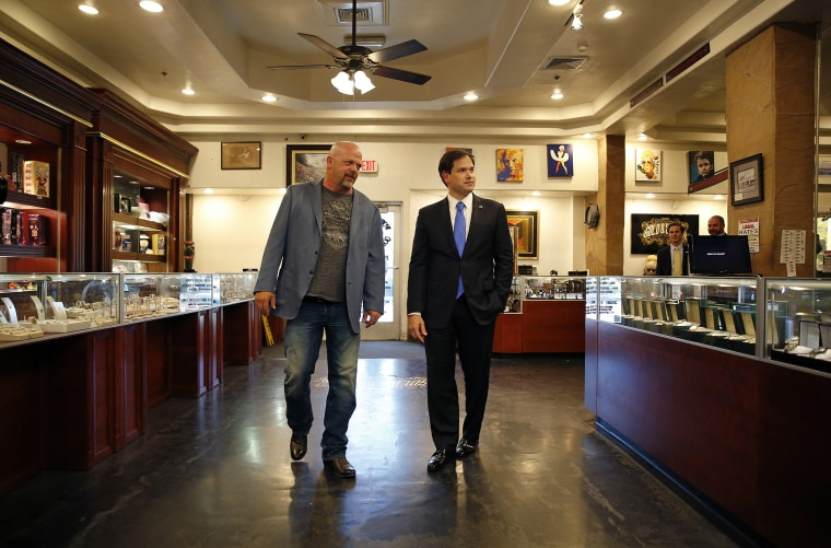Republican presidential candidate Sen. Marco Rubio, R-Fla., tours the World Famous Gold & Silver Pawn shop with owner Rick Harrison, May 28, 2015, in Las Vegas. (Photo by John Locher/AP)