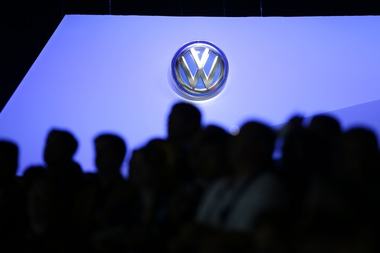 The Volkswagen logo is displayed as people gather at the Los Angeles Auto Show, Nov. 20, 2013, in Los Angeles, Calif.  (Photo by Jae C. Hong/AP)