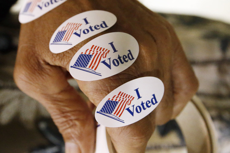 """I Voted"" stickers are seen ready to distribute to all who exit the voting booths, Aug. 4, 2015. (Photo by Rogelio V. Solis/AP)"