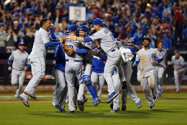 The Kansas City Royals celebrate defeating the New York Mets to win Game Five of the 2015 World Series at Citi Field on Nov. 1, 2015 in the Flushing neighborhood of the Queens borough of New York, N.Y. (Photo by Elsa/Getty)
