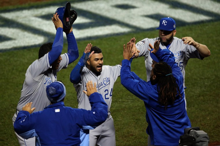Christian Colon #24 of the Kansas City Royals celebrates after scoring in the 12th inning against the New York Mets during Game Five of the 2015 World Series at Citi Field on Nov. 1, 2015 in New York, N.Y. (Photo by Doug Pensinger/Getty)