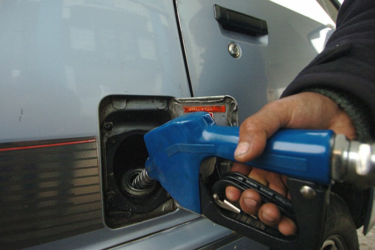 An Afghan fuel station employee fills the tank of a car. (Photo by Shah Marai/AFP/Getty)