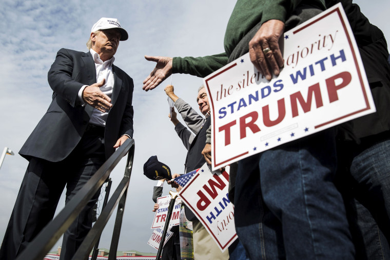 U.S. Republican presidential candidate Donald Trump shakes hands with a supporter during a campaign rally at the USS Wisconsin battleship in Norfolk, Va., Oct. 31, 2015. (Photo by Joshua Roberts/Reuters)
