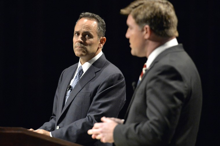 Kentucky Republican gubernatorial candidate Matt Bevin, left, looks on as Democratic candidate Jack Conway responds to a question during the League of Women Voters debate, Oct. 25, 2015, in Richmond, Ky. (Photo by Timothy D. Easley/AP)