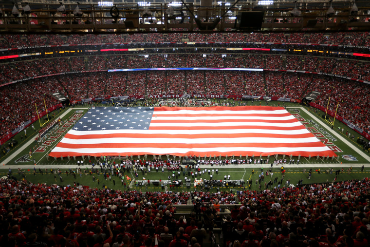 The United States flag covers the field during the national anthem before the Atlanta Falcons take on the San Francisco 49ers at the Georgia Dome on Jan. 20, 2013 in Atlanta, Ga. (Photo by Mike Ehrmann/Getty)
