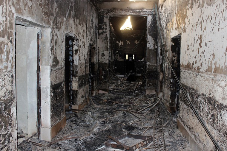 In this Friday, Oct. 16, 2015 photo, the charred remains of the Doctors Without Borders hospital is seen after being hit by a U.S. airstrike in Kunduz, Afghanistan. (Photo by Najim Rahim/AP)