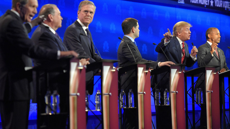 John Kasich, left, and Donald Trump, second from right, argue across fellow candidates during the CNBC Republican presidential debate at the University of Colorado, Oct. 28, 2015, in Boulder, Colo. (Photo by Mark J. Terrill/AP)
