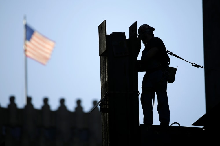 In this Sept. 15, 2015 photo, an iron worker works on a construction site in Philadelphia. (Photo by Matt Rourke/AP)