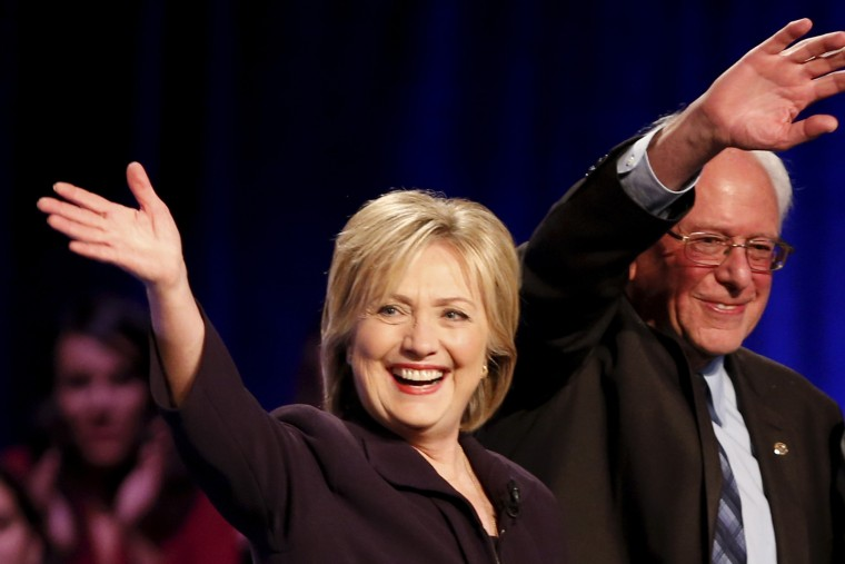 Democratic presidential candidates Hillary Clinton and Bernie Sanders wave following the First in the South Presidential Candidates Forum held at Winthrop University in Rock Hill, S.C. on Nov. 6, 2015. (Photo by Chris Keane/Reuters)