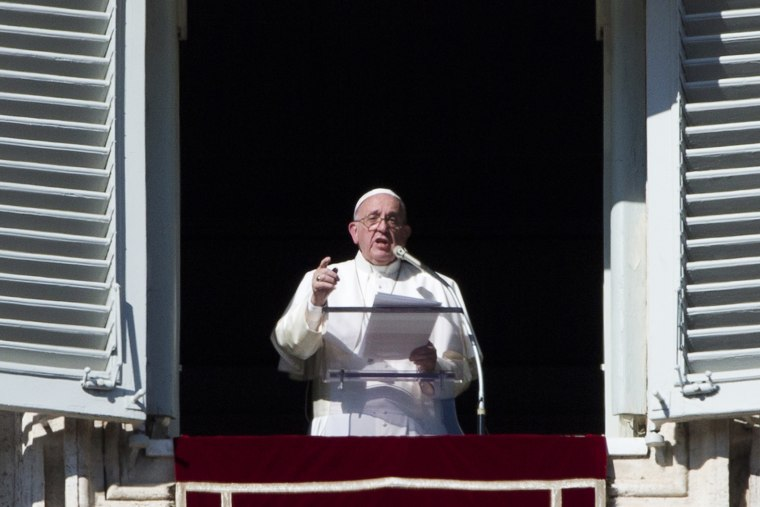Pope Francis delivers his message during his Angelus prayer from his studio window overlooking St. Peter's Square, at the Vatican, Sunday, Nov. 8, 2015. (Photo by Alessandra Tarantino/AP)