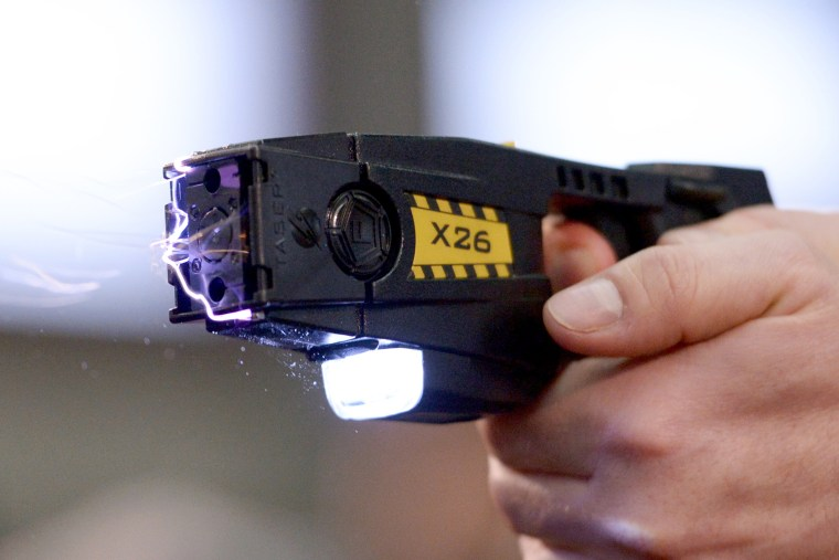 A taser is demonstrated, Nov. 18, 2013. (Photo by Rainer Jensen/AP)