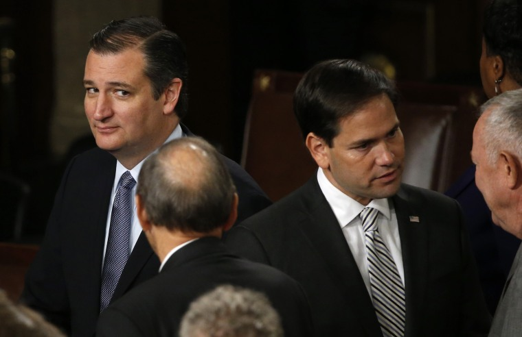 Presidential candidate Ted Cruz looks over at rival candidate Marco Rubio before a joint meeting of the U.S. Congress in the House of Representatives Chamber, Sept. 24, 2015. (Photo by James Lawler Duggan/Reuters)