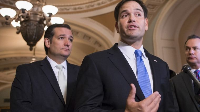 Sen. Marco Rubio, R-Fla., accompanied by Sen. Ted Cruz, R-Texas, speaks during a news conference on Capitol Hill in Washington, Sept. 27, 2013. (Photo by J. Scott Applewhite/AP)