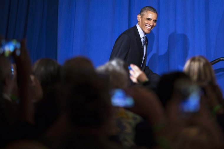 President Barack Obama smiles as he arrives to speak during a Organizing for Action event, on Nov. 9, 2015, in Washington, D.C. (Photo by Evan Vucci/AP)