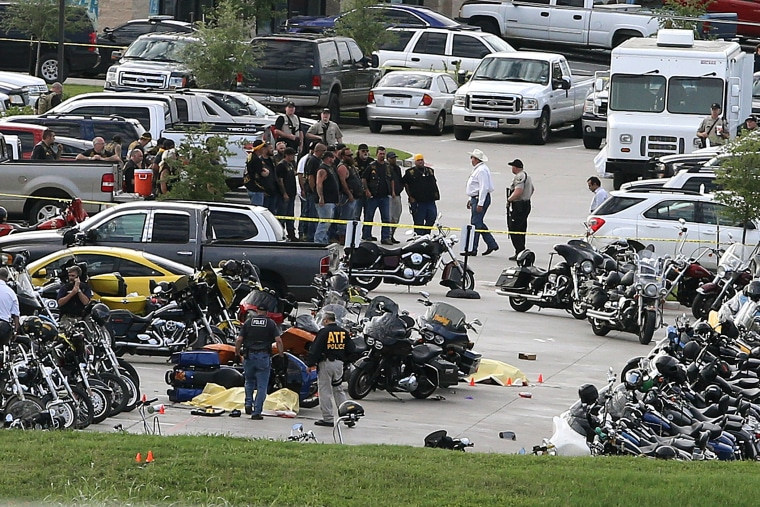 In this May 17, 2015 file photo, authorities investigate a shooting in the parking lot of the Twin Peaks restaurant, in Waco, Texas. (Photo by Jerry Larson/AP)