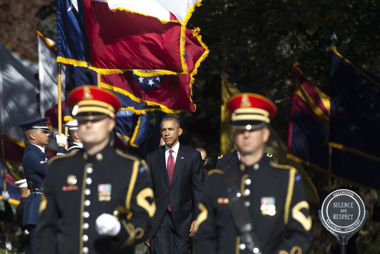 President Barack Obama arrives for a wreath laying ceremony at the Tomb of the Unknown Soldier in honor of Veteran's Day at Arlington National Cemetery in Arlington, Va., on Nov. 11, 2015. (Photo by Saul Loeb/AFP/Getty)