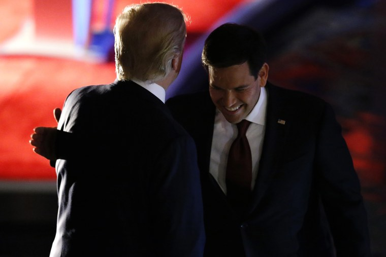 Marco Rubio pats Donald Trump on the back by during a commercial break at the debate held by Fox Business Network for the top 2016 U.S. Republican presidential candidates in Milwaukee, Wis., Nov. 10, 2015. (Photo by Jim Young/Reuters)