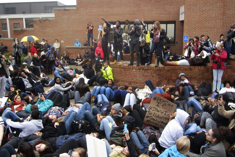 Protestors encourage students to lay down as part of a 'die-in' at Ithaca College in Ithaca, New York, Nov. 11, 2015. (Photo by Matthew Liptak/Reuters)