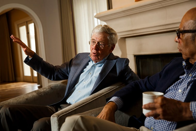 Charles Koch and Dr. Michael Lomax, president and chief executive officer of the United Negro College Fund, speak during an interview at the Freedom Partners Summit on Aug. 3, 2015 in Dana Point, CA. (Photo by Patrick T. Fallon/The Washington Post/Getty)