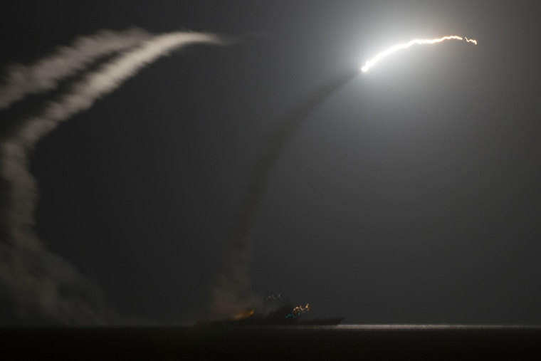 A handout picture released by the US Navy shows the guided-missile cruiser USS Philippine Sea (CG 58) launching a Tomahawk cruise missile against IS (Islamic State) targets in Syria, as seen from the aircraft carrier USS George H.W. Bush (CVN 77) in the A