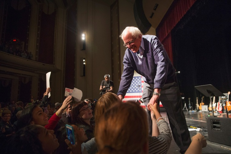Democratic presidential candidate Senator Bernie Sanders (I-VT) greets guests at an event he was hosting to raise support for his campaign at the Adler Theater on Oct. 23, 2015 in Davenport, Iowa. (Photo by Scott Olson/Getty)