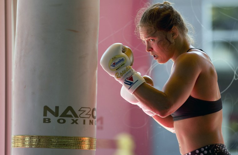 Mixed martial arts fighter Ronda Rousey works out at Glendale Fighting Club in Glendale, Calif., July 15, 2015. (Photo by Jae C. Hong/AP)