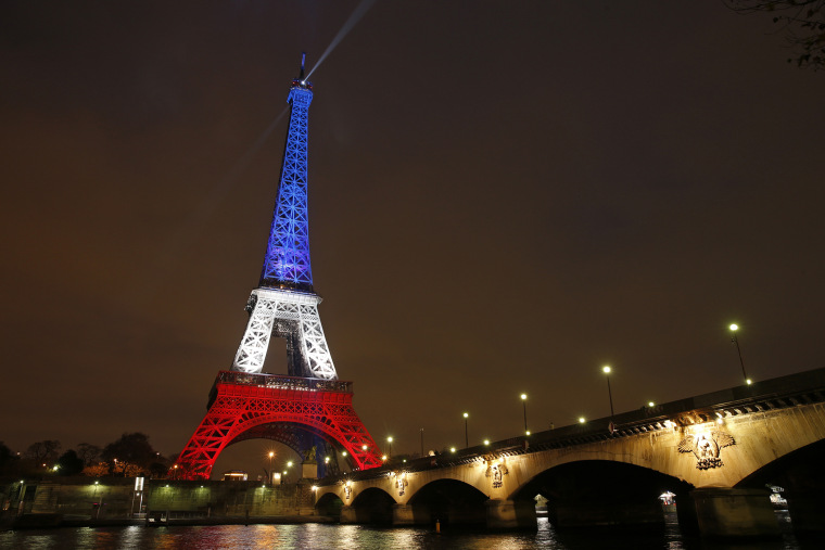 The Eiffel Tower is lit with the blue, white and red colors of the French flag in Paris, France, Nov. 16, 2015, to pay tribute to the victims of a series of deadly attacks on Friday in the French capital. (Photo by Benoit Tessier/Reuters)