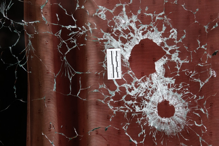 Bullet impacts are seen in the window of the Le Carillon restaurant the morning after a series of deadly attacks in Paris, Nov. 14, 2015. (Photo by Christian Hartmann/Reuters)
