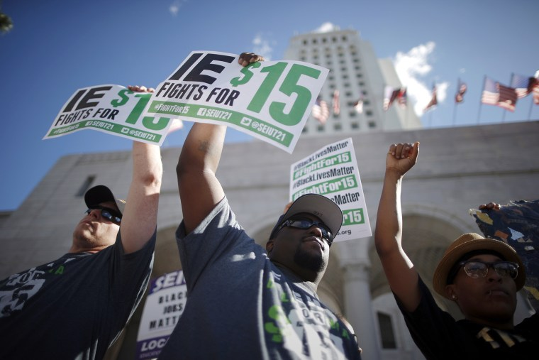 Fast-food workers and their supporters join a nationwide protest for higher wages and union rights outside City Hall in Los Angeles, Calif, Nov. 10, 2015. (Photo by Lucy Nicholson/Reuters