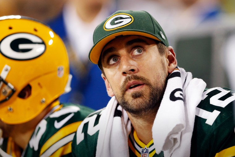 Aaron Rodgers, #12 of the Green Bay Packers, looks on from the bench during a game at Lambeau Field on Sept. 20, 2015 in Green Bay, Wis. (Photo by Christian Petersen/Getty)