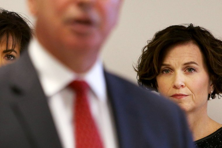 Minneapolis mayor Betsy Hodges, on right, listens as Hennepin County Attorney Mike Freeman speaks during a press conference at City Hall. Nov. 13, 2015, in Minneapolis, Minn. (Photo by David Joles/Minneapolis Star Tribune/ZUMA)