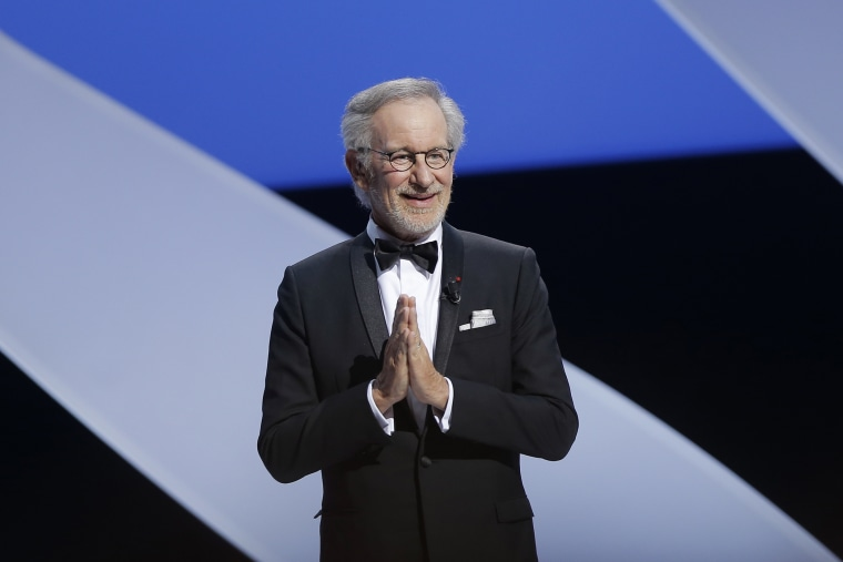 Director and jury president Steven Spielberg gestures to an applauding audience at Cannes, southern France, May 15, 2013. (Photo by Francois Mori/AP)