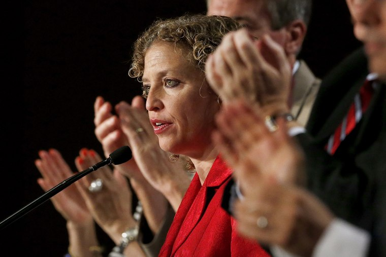 During a standing ovation, Democratic National Committee chair, Rep. Debbie Wasserman Schultz, D-Florida, speaks to party members during their summer meeting on, Aug. 23, 2013, in Scottsdale, Ariz. (Photo by Ross D. Franklin/AP)