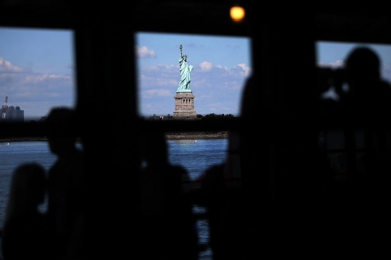 People view the Statue of Liberty in New York, N.Y. (Photo by Spencer Platt/Getty)