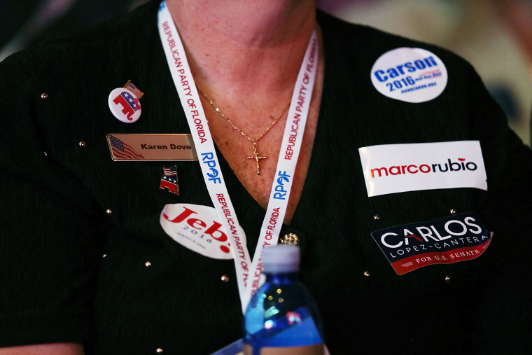 An attendee shows her support for Republican presidential candidates during the Sunshine Summit conference being held at the Rosen Shingle Creek on Nov. 13, 2015 in Orlando, Fla. (Photo by Joe Raedle/Getty)