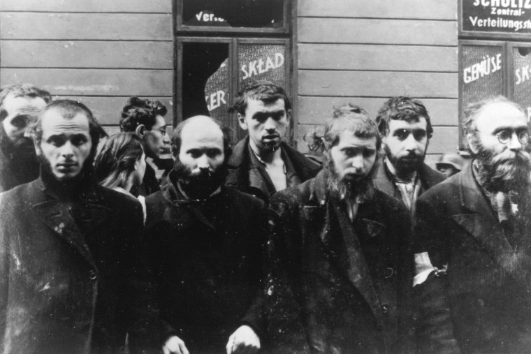 A group of religious Jews are held under arrest by German SS soldiers, April/May 1943, during the destruction of the Warsaw Ghetto by German troops, following an uprising in the Jewish quarter. (Photo by AP)