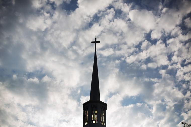 The sun rises behind the steeple of a church, Aug. 23, 2015, in Plains, Ga. (Photo by David Goldman/AP)
