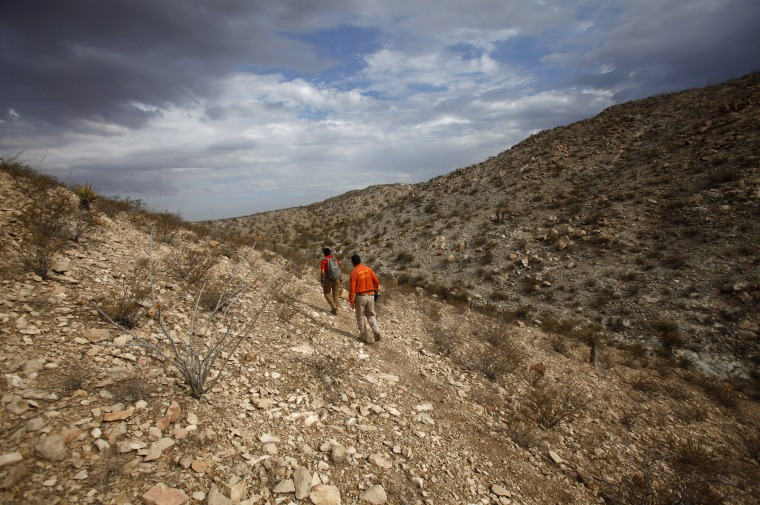Members of Mexican immigrant welfare agency Grupo Beta search in the mountains between Mexico and the U.S. for potential border crossers during a patrol on the outskirts of Ciudad Juarez, July 29, 2014. (Photo by Jose Luis Gonzalez/Reuters)