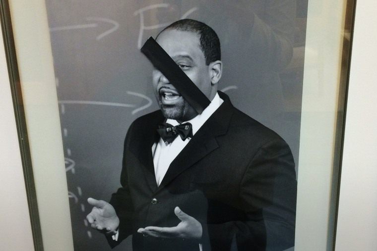 This photo taken by a Kidist Keaton, a 3rd year student at the university, shows a defaced portrait of a black faculty member of Harvard Law School. (Photo by Kidist Keaton)