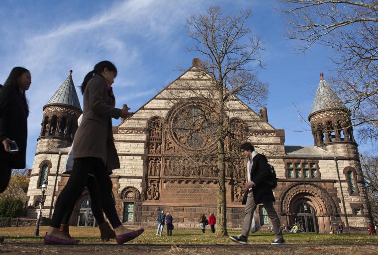 People walk around the Princeton University campus, N.J., Nov. 16, 2013. (Photo by Eduardo Munoz/Reuters)