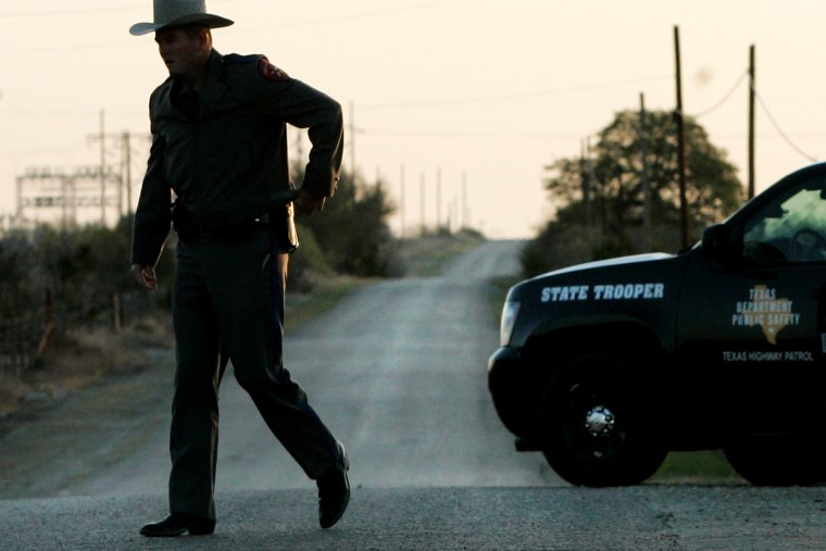 A Texas State Trooper at a roadblock, April 6, 2008, in Eldorado, Texas. (Photo by Tony Gutierrez/AP)