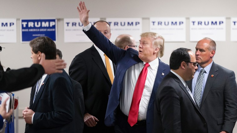 Republican presidential candidate Donald Trump waves to guests as he leaves a rally at Des Moines Area Community College Newton Campus on Nov. 19, 2015 in Newton, Iowa. (Photo by Scott Olson/Getty)