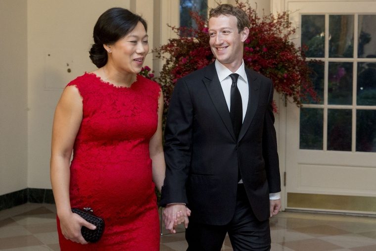 Mark Zuckerberg, chief executive officer and founder of Facebook Inc., and his wife Priscilla Chan arrive at a state dinner in honor of Chinese President Xi Jinping at the White House, Sept. 25, 2015. (Photo by Andrew Harrer/Bloomberg/Getty)
