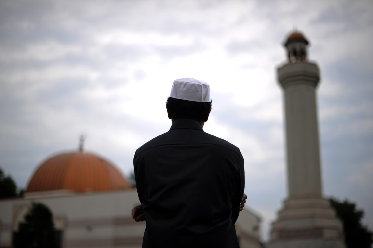 A man takes part in a special morning prayer at a mosque. (Photo by Jewel Samad/AFP/Getty)